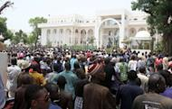 Thousands of Malians gather on in front of the presidential compound in Bamako during a protest against a transition deal giving coup leader Amadou Sanogo. Mali's transition president Diancounda Traore was hospitalised Monday after protesters angry at his appointment in a deal struck with the junta burst into his office and beat him