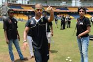 South African cricketer Jean-Paul Duminy (C) offers pointers to budding Sri Lankan cricket players at the R. Premadasa stadium in Colombo, on September 26. The South African team took time off to coach Sri Lankans as part of their HIV prevention awareness program in collaboration with the International Cricket Council and the United Nations