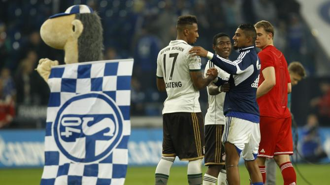 Schalke 04's Kevin Prince Boateng hugs his brother Jerome Boateng of Bayern Munich after the German first division Bundesliga soccer match in Gelsenkirchen