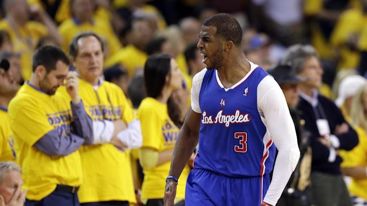 Los Angeles Clippers' Chris Paul (3) celebrates after making a 3-point basket against the Golden State Warriors during the second half in Game 3 of an opening-round NBA basketball playoff series on Thursday, April 24, 2014, in Oakland, Calif. Los Angeles won 98-96