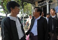 This picture taken on March 4, 2013 shows lawyers talking outside a court in Yangon. Rights groups say impunity for recent outbreaks of communal unrest -- and alleged army abuses in ethnic conflicts -- have shown the law is struggling to keep pace with tumultuous political, social and economic change
