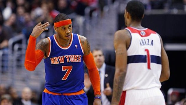 Carmelo Anthony of the New York Knicks celebrates in front of Trevor Ariza of the Washington Wizards (AFP)