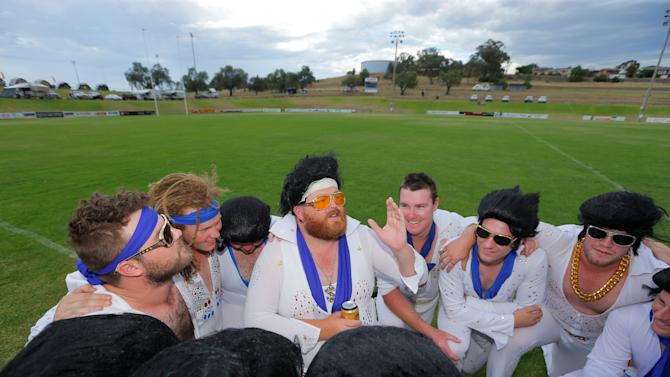 Amateur rugby team captain Chris Summerhayes gives a pep talk to his teammates from the Blue Suede Shoes prior to their rugby union game against the Reddy Teddies during the 25th annual Parkes Elvis Festival in the rural Australian town of Parkes