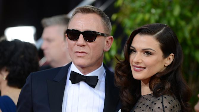 "FILE - In this Jan. 13, 2013 file photo, Daniel Craig, left, and Rachel Weisz arrive at the 70th Annual Golden Globe Awards at the Beverly Hilton Hotel in Beverly Hills, Calif.   Craig and Weisz are to play an adulterous stage couple in a Broadway production of Harold Pinter's ""Betrayal.""  Broadway veteran Mike Nichols will direct the production, which previews from Oct. 1 and opens Nov. 3 at New York's Barrymore Theatre. The announcement was made Friday, April 5, 2013. (Photo by Jordan Strauss/Invision/AP)"