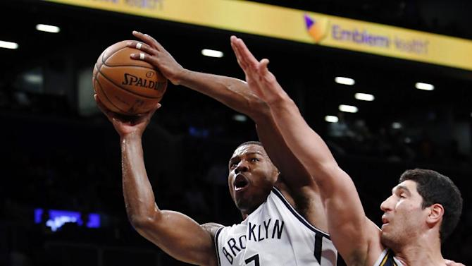 Brooklyn Nets' Joe Johnson (7) goes to the basket against Utah Jazz's Enes Kanter (0) during the second half of an NBA basketball game Tuesday, Nov. 5, 2013, in New York. Brooklyn won 104-88