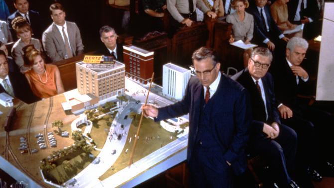 """This image provided by Warner Bros. from Oliver Stone's 1991 movie """"JFK"""" shows Kevin Costner as New Orleans District Attorney Jim Garrison demonstrating the """"magic bullet"""" theory. Critics say Stone's film has done more than anything to shape the public's perception of President John F. Kennedy's assassination. """"He made this kind of paranoid conspiracy theory respectable,"""" says New York writer Arthur Goldwag, author of """"Cults, Conspiracies, and Secret Societies."""" The movie tells the story of a New Orleans District Attorney played by Kevin Costner. Garrison remains the only prosecutor to bring someone to trial for an alleged conspiracy to kill Kennedy. (AP Photo/Warner Bros.)"""