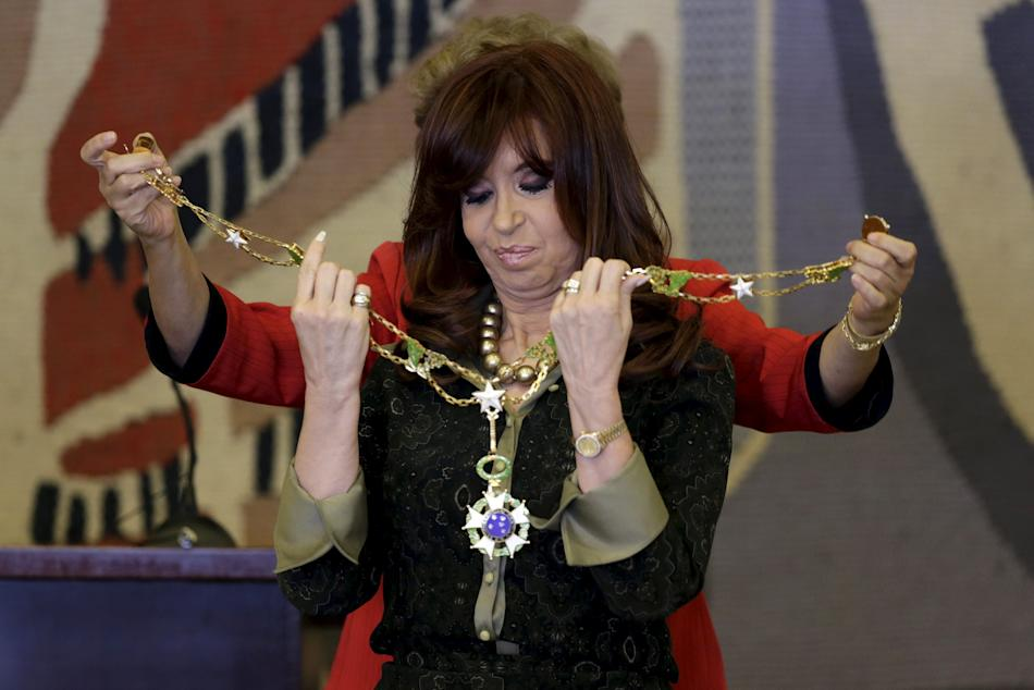 Argentina's President Cristina Fernandez de Kirchner receives the Order Medal Of Cruzeiro Do Sul, during the Summit of Heads of State of MERCOSUR and Associated States and Meeting of the Common Ma