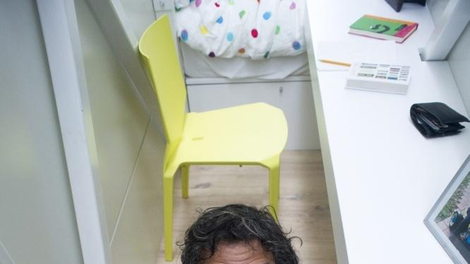 World's thinnest house Keret at desk looking up