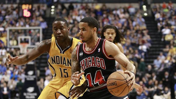 Chicago Bulls guard D.J. Augustin (14) drives on Indiana Pacers guard Donald Sloan in the first half of an NBA basketball game in Indianapolis, Friday, March 21, 2014