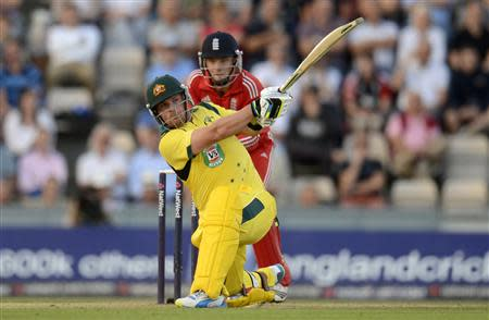 Australia's Finch hits out watched by England's Buttler during the first T20 international at the Rose Bowl cricket ground, Southampton