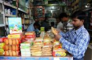 An Indian man shops in New Delhi in 2011. India's consumer spending is at its weakest in seven years, global ratings agency Fitch said on Tuesday, as it cut the outlook for India's vast retail sector from stable to negative