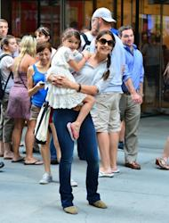 A smiling Katie Holmes and Suri Cruise leave the Museum of Modern Art in New York City, August 6, 2012 -- Getty Premium
