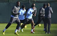 Manchester City's Mario Balotelli (L) during a team training session in Manchester, north-west England, on November 5. Roberto Mancini's side will attempt to recover from yet another European disappointment when they return to Premier League action against Tottenham Hotspur on Sunday
