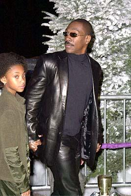 Premiere: Eddie Murphy with his daughter at the Universal Amphitheatre premiere of Universal's Dr. Seuss' How The Grinch Stole Christmas - 11/8/2000