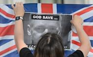 A supporter of Wikileaks founder Julian Assange pastes up a protrait of Assange onto a Union Flag outside the Supreme Court in central London on May 30. The court ruled Assange can be extradited to Sweden, but put his deportation on hold to give his lawyers a final chance to reopen the case