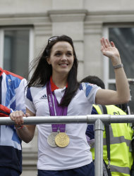 Britain's cyclist Victoria Pendleton waves to the crowds as the Team GB Olympic and Paralympic teams parade in the streets of London, Monday, Sept. 10, 2012. Our Greatest Team Parade, the procession of athletes, celebrates the achievements of British Olympians and Paralympians at the London 2012 Games. (AP Photo/Lefteris Pitarakis)