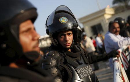 "An Egyptian special forces policeman takes his position in front of the main gate at the Borg El Arab ""Army Stadium"" before 2018 World Cup qualifying soccer match between Egypt and Chad, in the Alexandria"