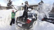 People in the Maritimes are digging out after heavy snow, while many residents in Newfoundland are without power