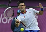 Serbia's Novak Djokovic returns the ball to France's Jo-Wilfred Tsonga during their men's singles quarter final match of the London 2012 Olympic Games. Djokovic set up an Olympic semi-final showdown with Andy Murray after beating Tsonga 6-1, 7-5