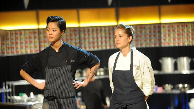"""This image released by Bravo shows chef contestants Kristen Kish, left, and Brooke Williamson in a scene from """"Top Chef: Seattle.""""  Kish and Williamson are finalists in the cooking competition series airing Wednesdays at 10 p.m. EST on Bravo. (AP Photo/Bravo, David Moir)"""