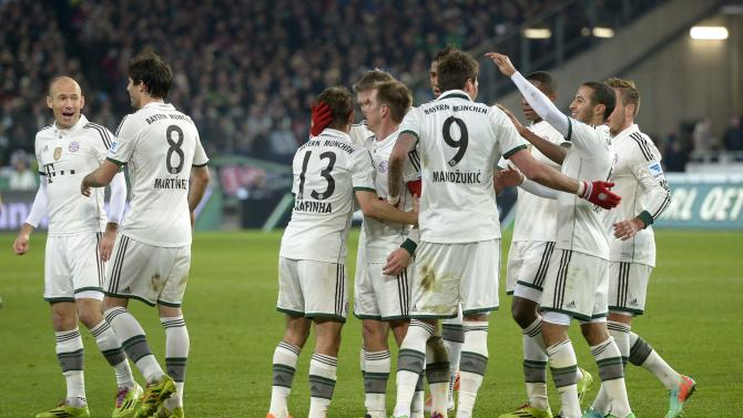 Bayern Munich's players celebrate after a goal was scored during the German Bundesliga first division soccer match against Hanover 96 in Hanover