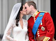 Britain's Prince William kisses his wife Catherine, Duchess of Cambridge, on the balcony of Buckingham Palace, after their wedding on April 29, 2011. Kate Middleton was the middle-class girl who made becoming a princess look easy -- but bringing up a royal baby will bring fresh challenges for Britain's glamorous future queen