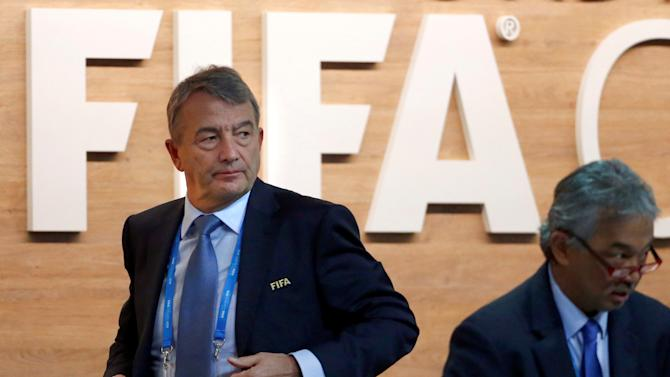 FIFA executive committee member Niersbach walks out of the stage during the Extraordinary Congress in Zurich