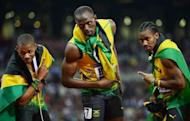 Jamaica's Usain Bolt (C) celebrates with teammates Yohan Blake (R) and Warren Weir after winning the men's 200m final at the athletics event during the London 2012 Olympic Games, on August 9. Jamaica's sprint kings will enter the home stretch of their golden Olympic campaign on Friday, as they return to the track for the 4x100 relay