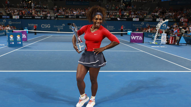 Williams of the U.S. poses with the trophy after defeating Pavlyuchenkova of Russia in their women's final match at the Brisbane International tennis tournament