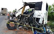 A view of the truck wreckage after it crashed into a bus in the Potrero-Alamo road stretch, in Veracruz state. Forty-three people were killed and 20 were injured Friday after a truck crashed into a bus carrying agricultural workers in Mexico's eastern Veracruz state, officials said