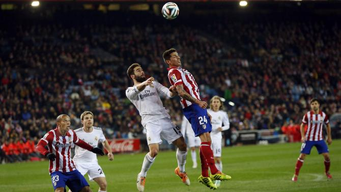 Atletico Madrid's Sosa fights for the ball with Real Madrid's Carvajal during their Spanish King's Cup semi-final second leg soccer match in Madrid