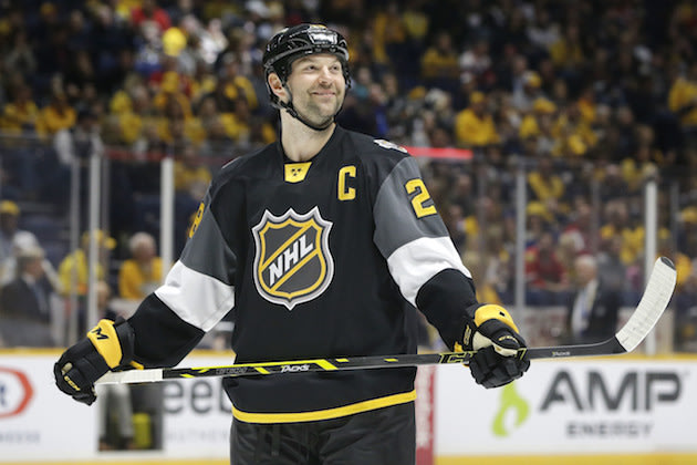 FILE - In this Jan. 31, 2016, file photo, Pacific Division forward John Scott looks into the stands during the NHL hockey All-Star championship game against the Atlantic Division, in Nashville, Tenn. The NHL is taking steps to avoid another John Scott situation at the All-Star Game. The league on Monday. Nov. 21, 2016, announced new fan voting rules that disqualify players from being named All-Star captains if they're injured or sent to the American Hockey League. Scott, a journeyman enforcer, was voted in by fans last year when he was with the Arizona Coyotes and still served as the Pacific Division captain despite being traded to the Montreal Canadiens and demoted to the AHL. (AP Photo/Mark Humphrey, File)