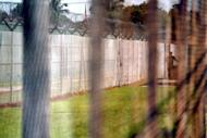 This file illustration photo shows a prison guard patroling the perimeter fence of a detention facility in Kamunting. A Malaysian high court on Monday jailed a man for more than five years for having sex with a 12-year-old girl, following outrage over an earlier verdict to free him on probation