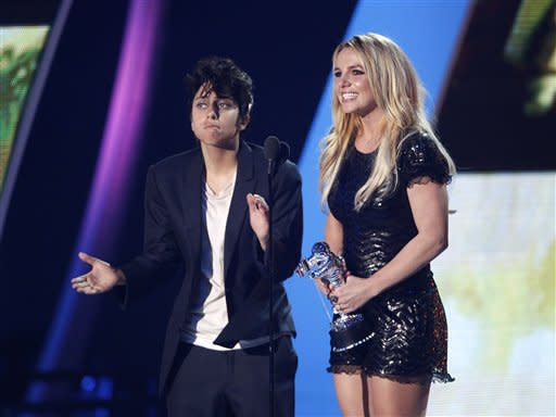 Lady Gaga, left, presents Britney Spears with the Video Vanguard award at the MTV Video Music Awards on Sunday Aug. 28, 2011, in Los Angeles. (AP Photo/Matt Sayles)