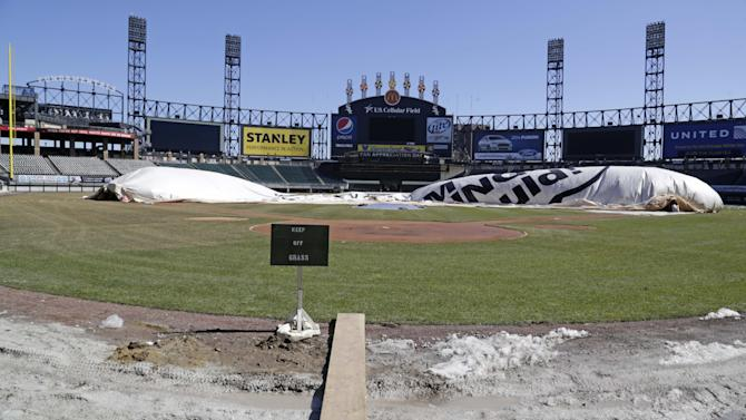 Before opening day, ballparks rush to thaw fields