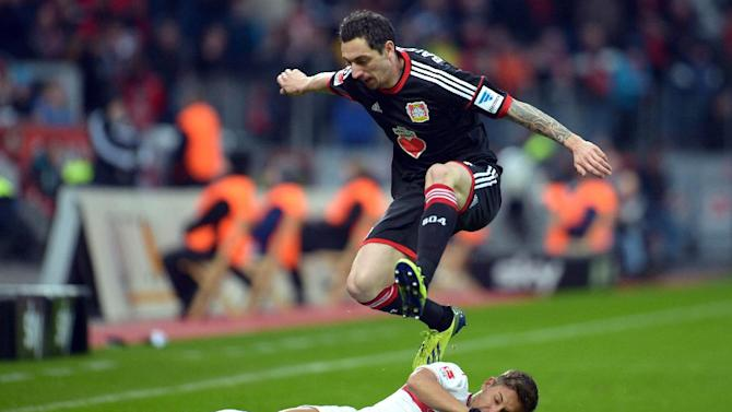 Leverkusen's  Roberto Hilbert , top, challenges for the ball with Stuttgart's  Moritz Leitner  during the German Bundesliga soccer match between Bayer Leverkusen and VfB Stuttgart in Leverkusen, Germany, Saturday Feb. 1, 2014