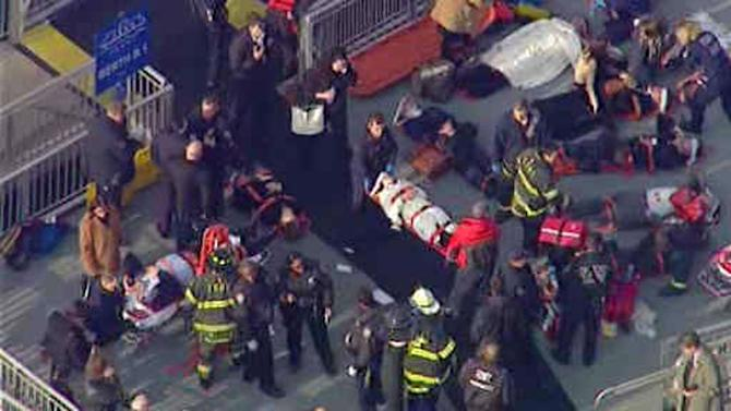 This aerial photo provided by WABC News Channel 7 shows emergency personnel at the scene of a ferry crash in Lower Manhattan, Wednesday, Jan. 9, 2013, in New York. The Fire Department says at least 50 people were injured when a ferry from New Jersey struck a dock during rush hour. (AP Photo/WABC News Channel 7)