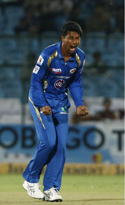 MI Bowler Pragyan Ojha celebrates fall of wicket during the match between Lions and Mumbai Indians at Sawai Mansingh Stadium, Jaipur on Sept. 27, 2013. (Photo: IANS)