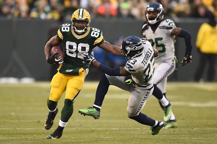 Ty Montgomery of the Green Bay Packers is pursued by Steven Terrell of the Seattle Seahawks during a game at Lambeau Field . (Photo by Stacy Revere/Getty Images)