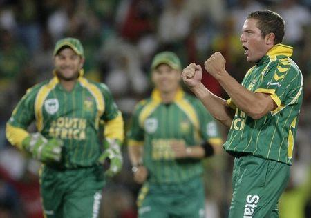 South Africa's Roelof van der Merwe celebrates during their second Twenty20 cricket match against Australia in Pretoria