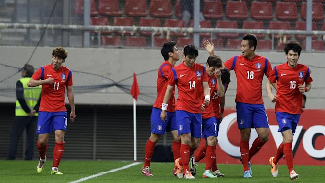 South Korea's Son Heungmin, left, with his teammates celebrates after scoring the second goal of his team during a friendly match at Georgios Karaiskakis stadium against Greece in Piraeus port, near Athens, Wednesday, March 5, 2014