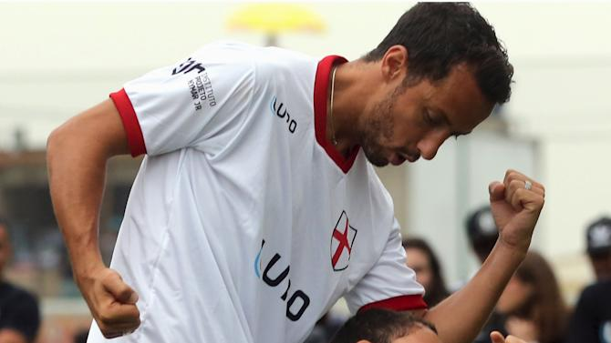 """Disabled child Rikellmy reacts with former soccer player Nene after they scored a goal during a """"World Boots"""" event for children with disabilities, at the Neymar Institute in Praia Grande"""