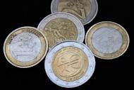 Greek euro coins. The euro extended its slide against the dollar Friday, dipping below $1.25, under pressure from uncertainty over the future of Greece in the eurozone, and the risk of contagion from its debt crisis