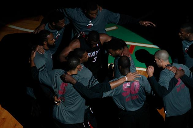 Dwyane Wade #3 And LeBron James #6 Of The Miami Heat Huddle Up With Their Teammates Getty Images
