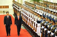 "Chinese President Hu Jintao (L) and Colombian President Juan Manuel Santos (R) review the Chinese military honor guard during an official welcoming ceremony at the Great Hall of the People in Beijing. Santos said China was ""very interested"" in investing in a pipeline going through his country, as Beijing seeks to secure more oil to fuel its economy"