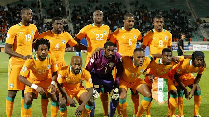 In this Nov. 16, 2013 file photo, Ivory Coast soccer team poses prior to the World Cup 2014 qualifying soccer match between Ivory Coast and Senegal at Mohammed V stadium in Casablanca, Morocco. Background from left: Yaya Toure, Toure Kolo Abib, Souleman Bamba, Romaric N'Dri,  and Salomon Kalou. Foreground from left: Gosso Jean-Jacques, Zokora  Deguy, goalkeeper Barry Boubacar, Didier Drogba, Aurier Serge and Yao Kouassi Gervais. The draw for the 2014 World Cup finals takes place Friday Dec. 6, 2013 near Salvador, Brazil. The 32 teams will be drawn into eight groups of four. The top two in each group will progress to the knockout stages. Twelve stadiums in twelve cities will host matches