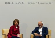 European Union foreign policy chief Catherine Ashton (L) speaks with Iranian Foreign Minister Mohammad Javad Zarif during a photo opportunity before the start of two days of closed-door nuclear talks at the United Nations European headquarters in Geneva November 7, 2013. REUTERS/Denis Balibouse