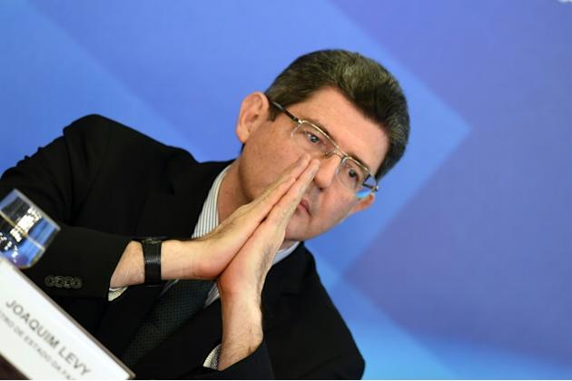 Brazilian Finance Minister Joaquim Levy gestures during a news conference on August 31, 2015, at the Planalto Palace in Brasilia, after presenting the budget for 2016 to the congress
