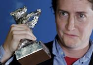 """US director David Gordon Green holds the Silver Bear best director award for """"Prince Avalanche"""" at the Berlin film festival on February 16, 2013. The comedy stars Paul Rudd and Emile Hirsch as highway maintenance workers in Texas at crossroads in their lives"""