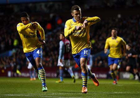 Arsenal's Jack Wilshere celebrates with teammate Serge Gnabry after their first goal during their English Premier League soccer match against Aston Villa at Villa Park in Birmingham